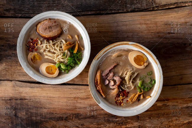 Two traditional Japanese pork ramen bowls