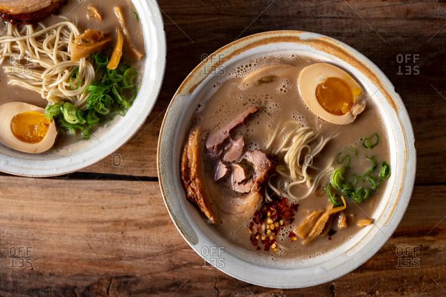 Traditional Japanese pork ramen bowls close up