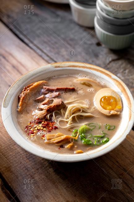 Traditional Japanese pork ramen bowl close up