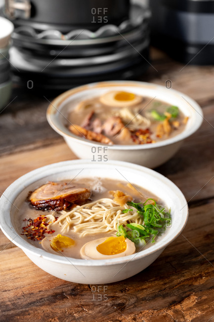 Side view of two traditional Japanese pork ramen bowls