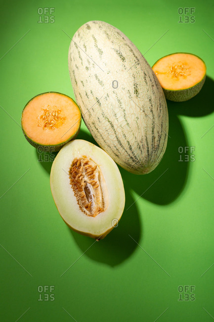 Ripe melons on green background