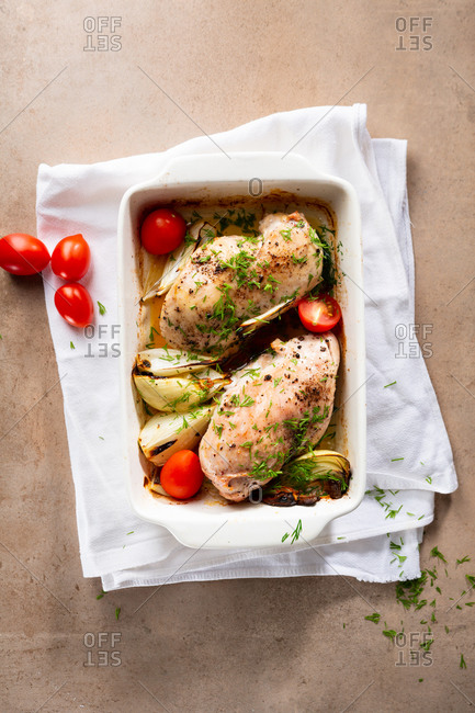 Roasted chicken meat in a baking dish