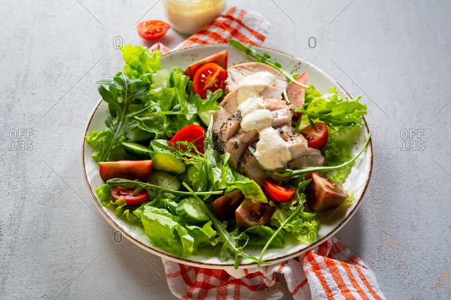Close up of a chicken salad with vegetables