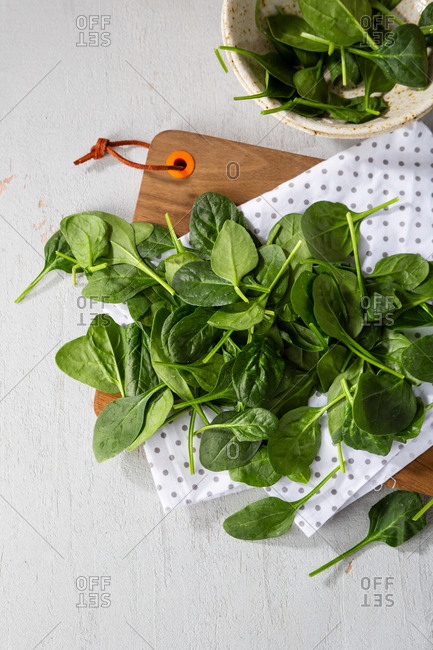 Fresh spinach leaves on kitchen board