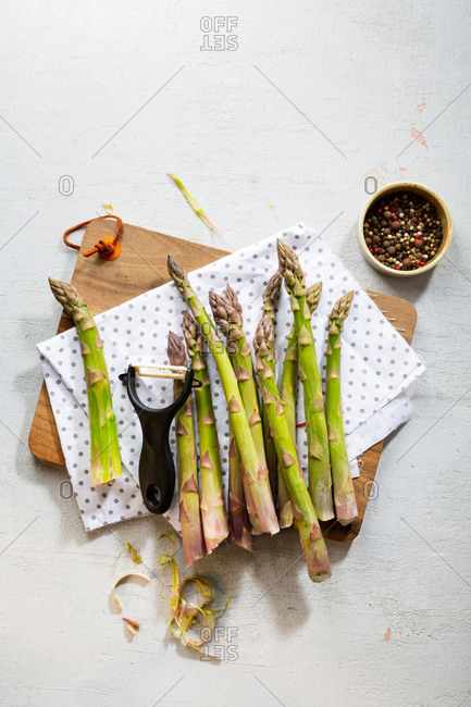 Overhead view of asparagus and peeler