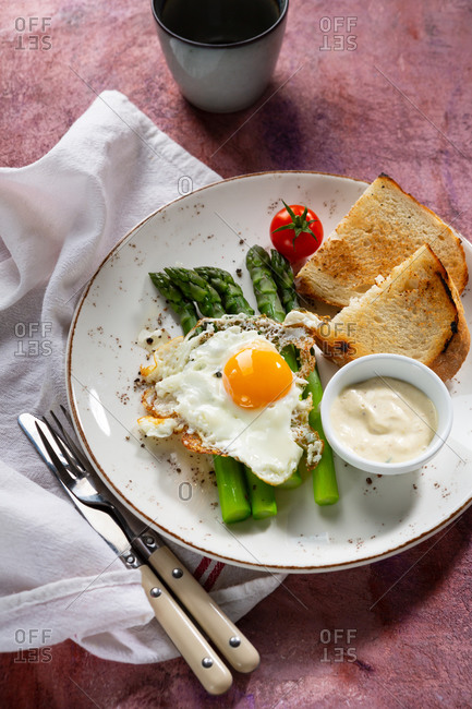 Asparagus with fried egg and toast ready to eat