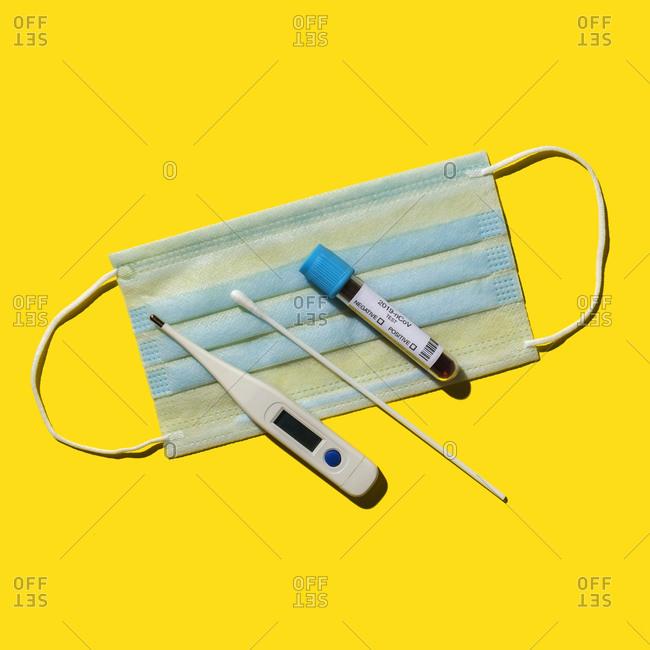Testing kit for Coronavirus on yellow background