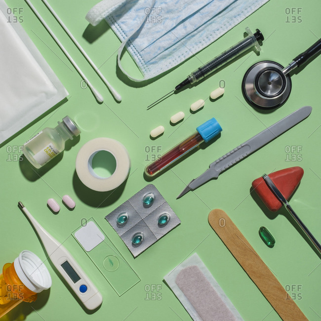 Medical supplies on green background