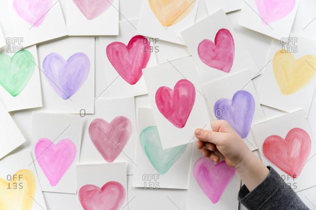Child holding homemade Valentine card