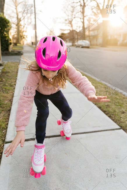Rollerskating girl losing balance