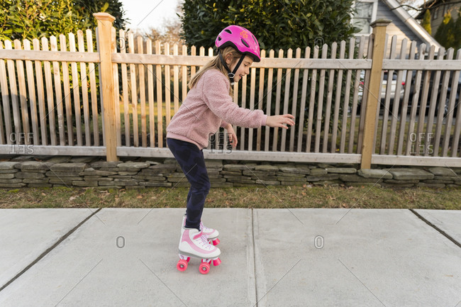 Girl learning how to rollerskate