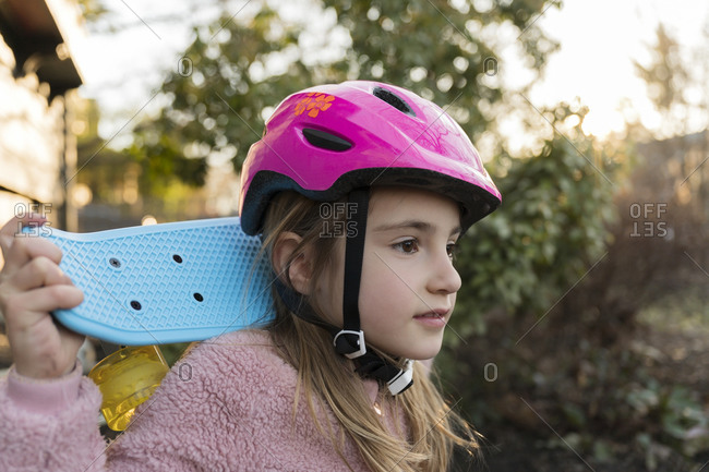 Portrait of girl with skateboard