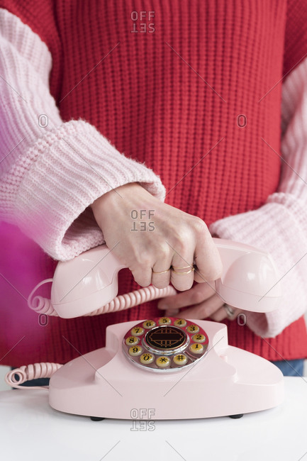 Woman holding vintage phone in her hand