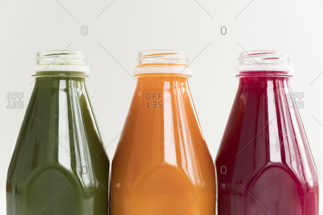 Healthy juices in a row all lined up