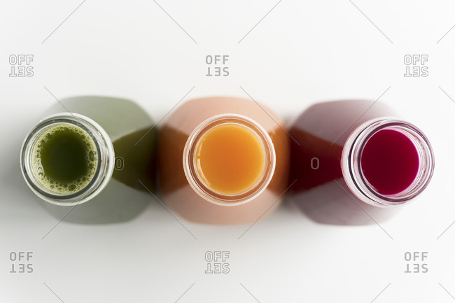 Healthy bottled juices shot from above