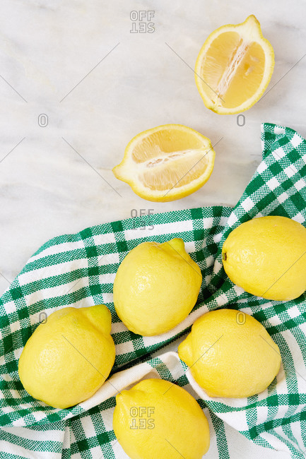 Fresh lemon on green cloth layed out