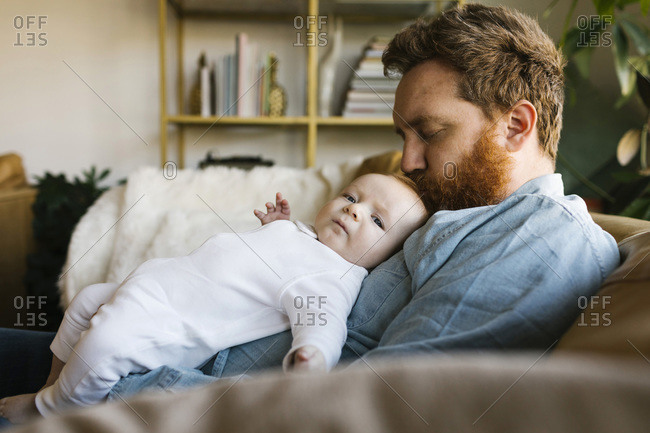 Father kissing baby son (2-3 months)