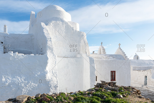 White rough walls of historic orthodox church in Mykonos, Greece.