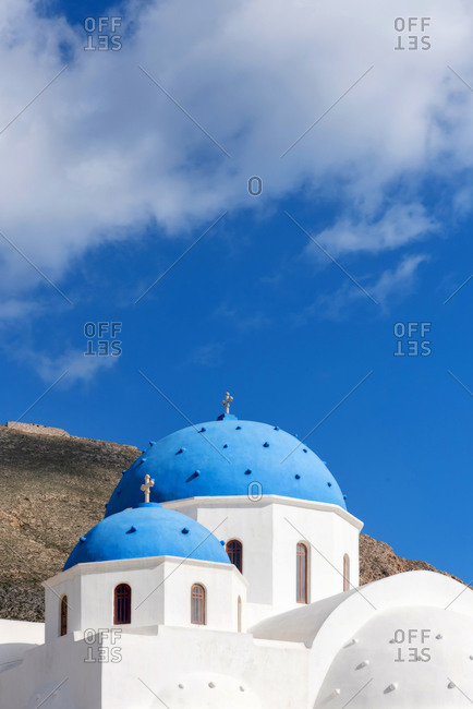Blue domes of an Orthodox Church at sunrise in Santorini, Greece
