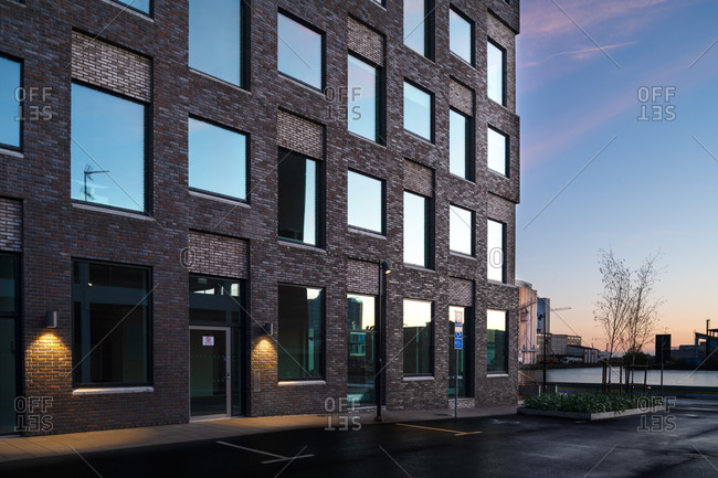 Malmo, Sweden - April 30, 2020: A modern office building in downtown Malmo at sunrise