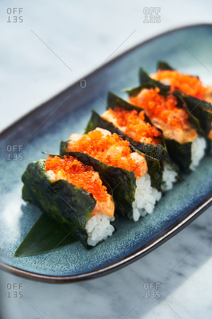 Sushi appetizer with rice, fish and spicy mayo