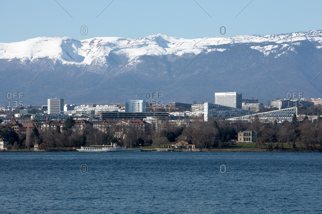 View of Geneva with lake and snowed mountains