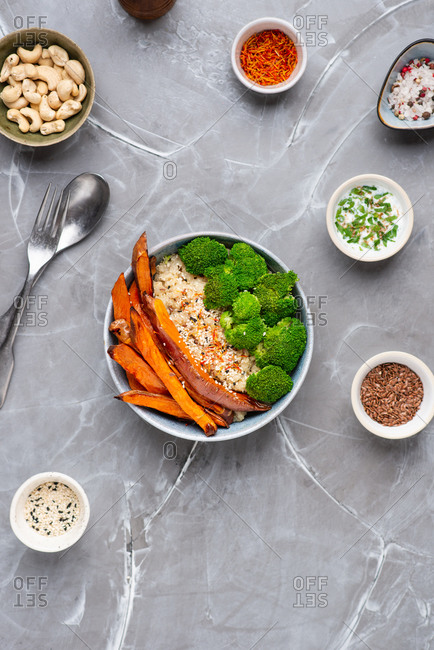 Healthy quinoa bowl with broccoli, roasted sweet potato and sesame seeds
