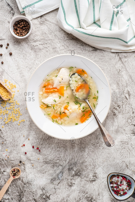 Chicken soup with noodles from above. Broth with chicken, carrot and dill