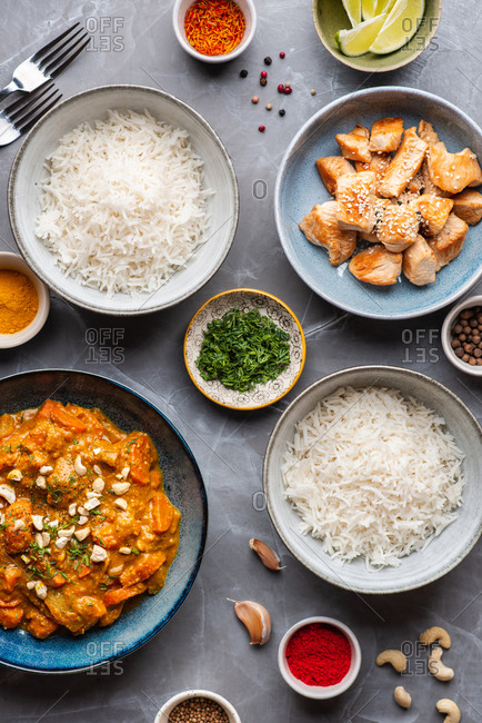 Indian food Curry butter chicken with cashew and basmati rice on gray background