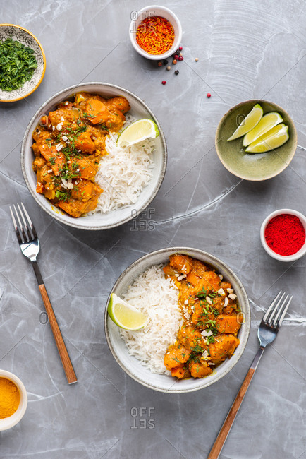 Indian food Curry butter chicken with basmati rice on gray background