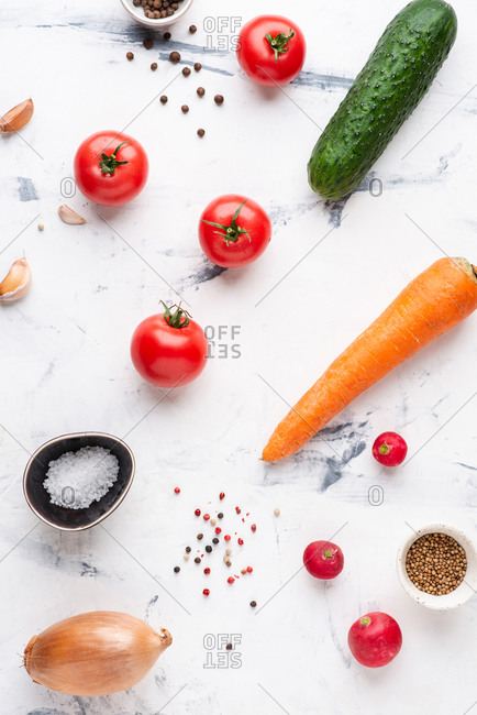 Set of various fresh vegetables and spices over white background