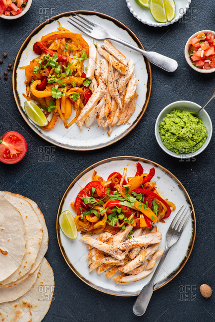 Chicken fajitas served with roasted vegetables, tortillas and salsa