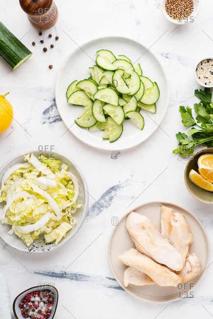 Chicken salad with chinese cabbage, cucumber, greens and sesame seeds