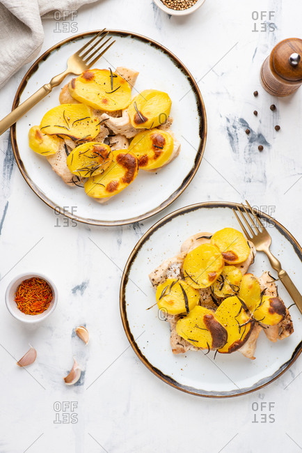 Roasted chicken fillet with baked sliced potato with rosemary