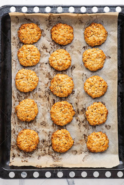 Overhead view of freshly baked oatmeal cookies on baking tray
