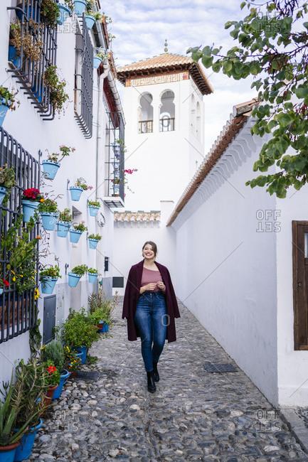 Woman walking in an alley in Albaicin- Granada- Spain