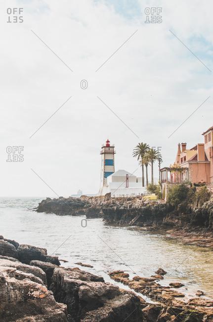 Portugal- Lisbon District- Cascais- Rocky coastline and Santa Marta Lighthouse