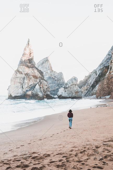 Young woman at Praia da Ursa- Lisboa- Portugal