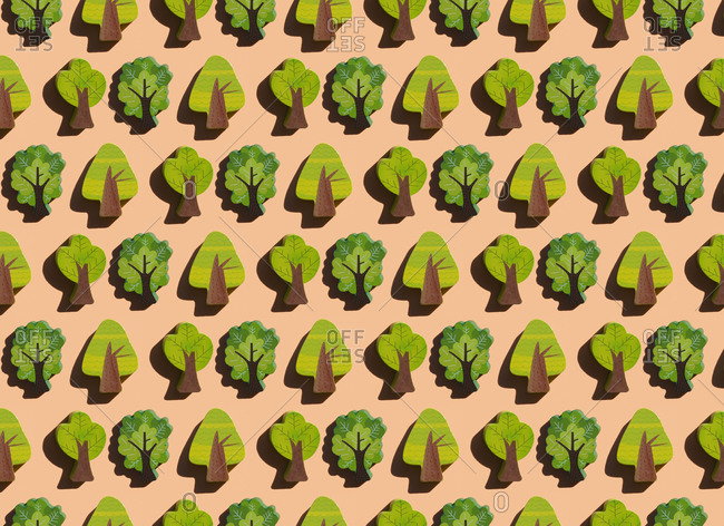 Pattern of rows of small wooden trees