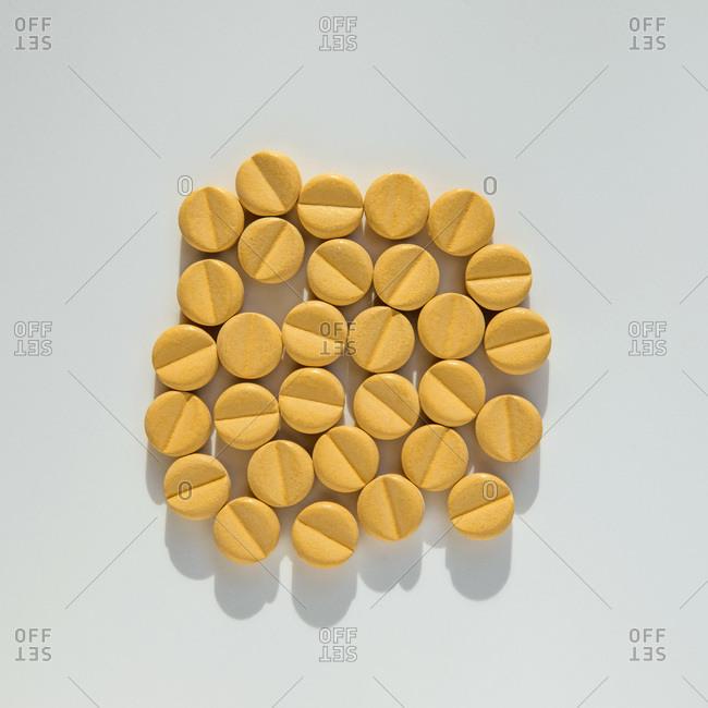 Studio shot of bunch of yellow pills