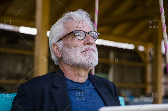 Portrait of pensive senior man looking at distance