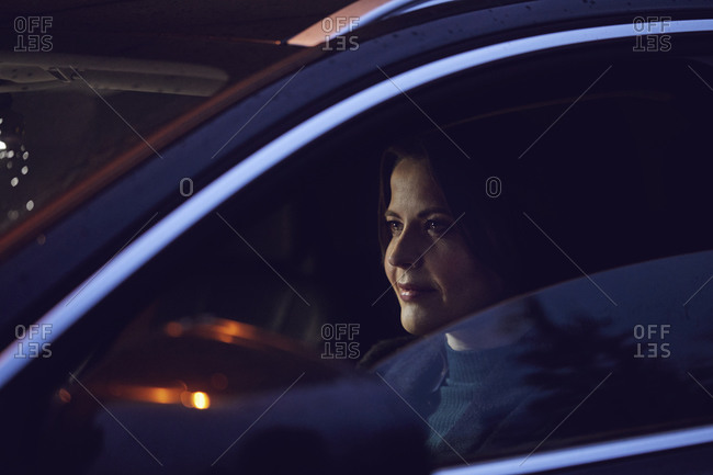 Portrait of confident woman in car at night