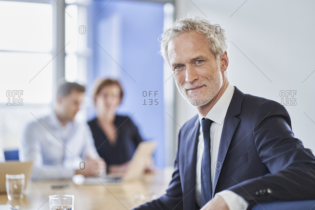 Portrait of confident manager during a meeting in office