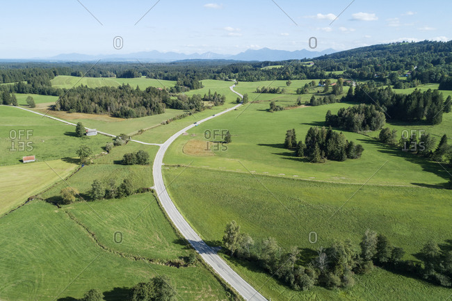 Germany- Bavaria- Drone view of rural road and green countryside in summer