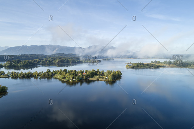 Germany- Bavaria- Murnau am Staffelsee- Drone view of fog floating over Gradeneiland- Worth and Buchau islands on Staffelsee lake