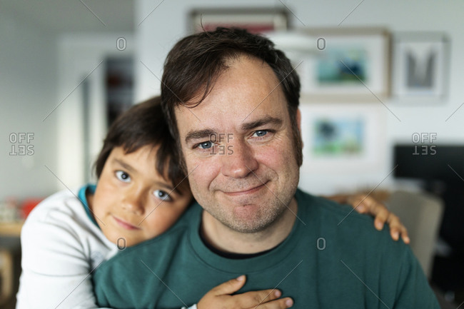 Portrait of father at home with his son