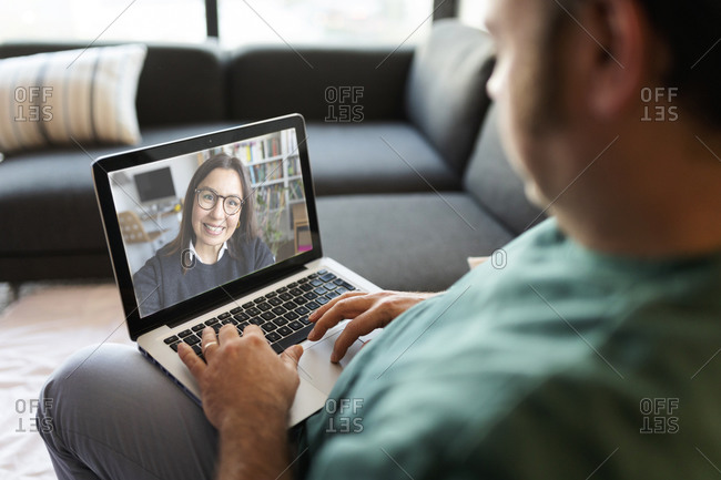 Man using laptop for video chat at home