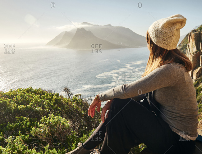 Woman enjoying the view from the top of a mountain- Chapman's Peak Drive- South Africa