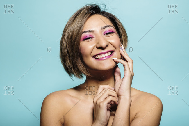 Soft skin beautiful woman with short hair on a blue background
