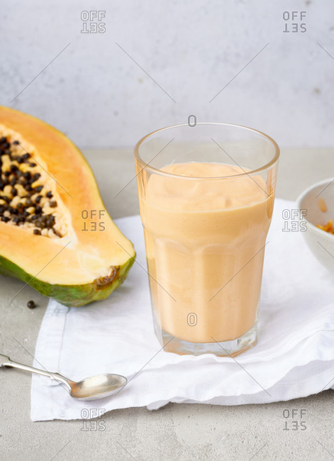 Papaya smoothie made with coconut milk. Vegan summer beverage
